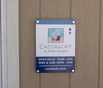 Small sign on wall displaying the house of operations for Castaway property.