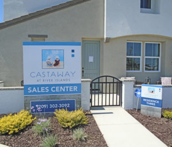 Front facade of Castaway's sales center, featuring two signs flanking the entrance.