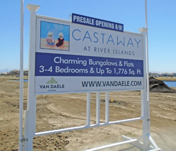 Blue and white sign on wood skid advertising Castaway property