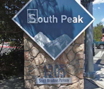 Diamond shaped sign identifying the South Peak Apartment complex.