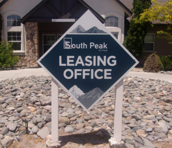 Diamond shaped outdoor sign identifying the Leasing Office